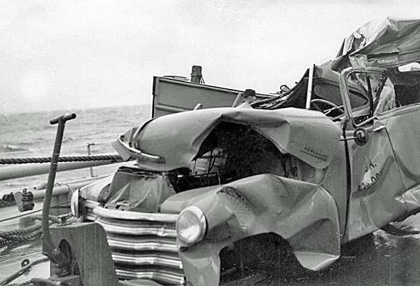 1031 Damaged vehicle on fantail